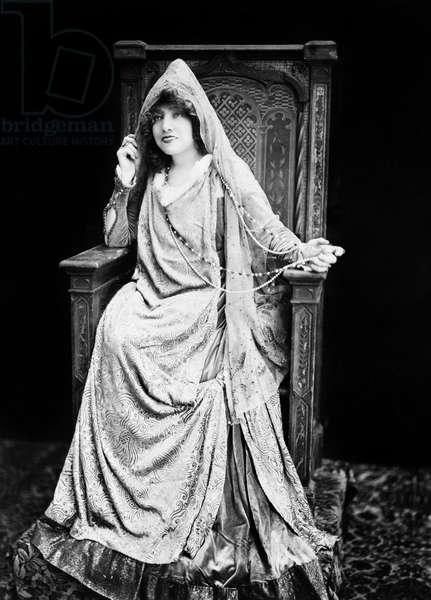 SARAH BERNHARDT (1844-1923) French actress. Photographed seated in throne-like chair, dressed in a costume in c.1890.