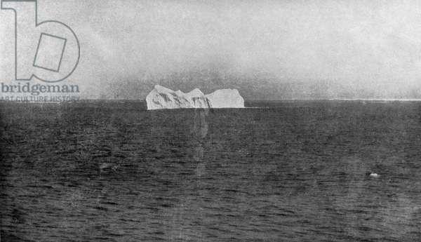 ICEBERG, 1912 An iceberg in the Atlantic Ocean, similar to the one that sank the 'Titanic.' Photograph, 1912.