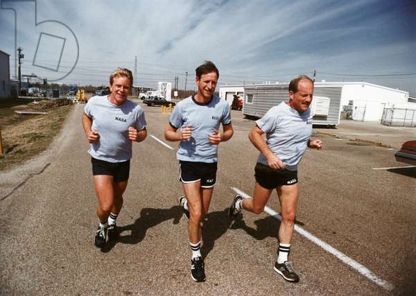 SPACE: TRAINING, 1988 NASA astronauts on a jog during training. Left to right: George Nelson, Richard Covey and Frederick Hauck. Photograph by Keith Meyers, 1988.