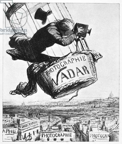 DAUMIER: NADAR, 1863 'Nadar elevating photography to art.' Lithograph, 1863, by Honore Daumier.