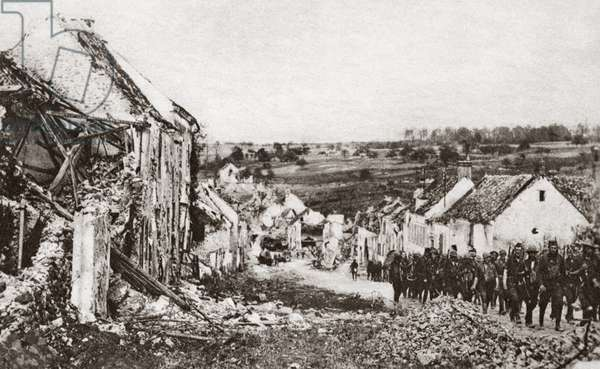 WORLD WAR I: FRENCH RUINS American troops passing through a ruined French town, captured after fighting during the Second Battle of the Marne. Photograph, 1918.