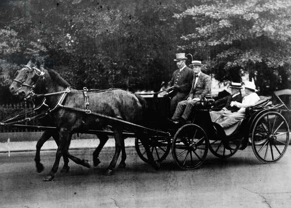 WOODROW WILSON (1856-1924) 28th President of the United States. President Wilson rides in a surrey with his wife, Edith. Photographed c.1915.