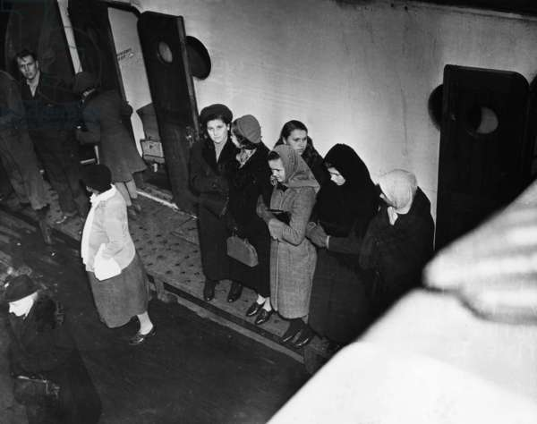ELLIS ISLAND, 1938 Immigrants arriving at Ellis Island aboard the S.S. President Harding. Photograph, 1938.