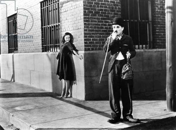 "CHAPLIN: MODERN TIMES, 1936 Charlie Chaplin and Paulette Goddard in a scene from the film, ""Modern Times"", 1936."