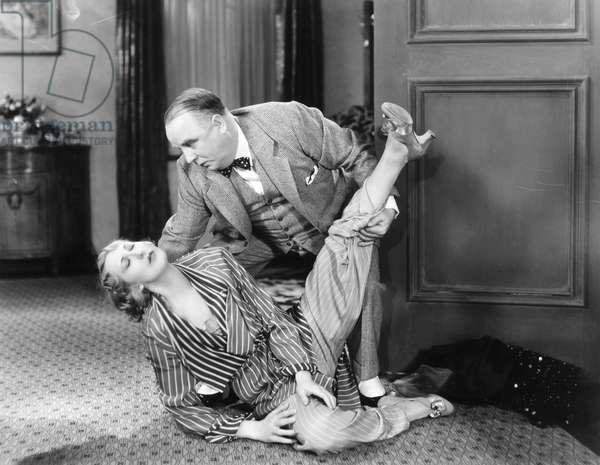 STEPPING OUT, 1931 Charlotte Greenwood and Harry Stubbs in a scene from the film.