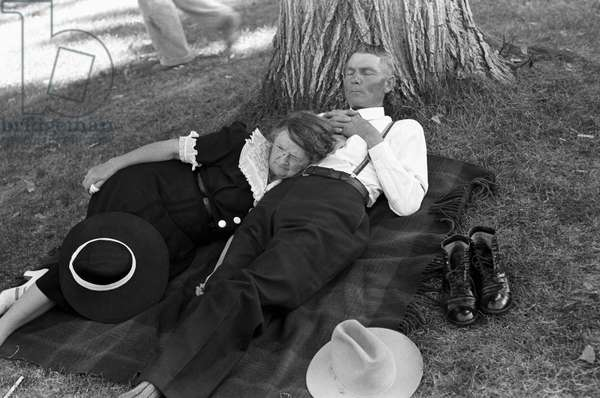 OREGON: COUPLE, 1941 A couple relaxing on a blanket under a shady tree after watching the Fourth of July parade in Vale, Oregon. Photograph by Russell Lee, July 1941.