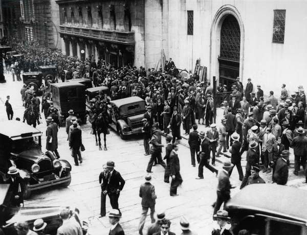 WALL STREET CRASH, 1929 Crowds gathered outside the New York Stock Exchange on Wall Street as stock prices collapse, late October 1929.
