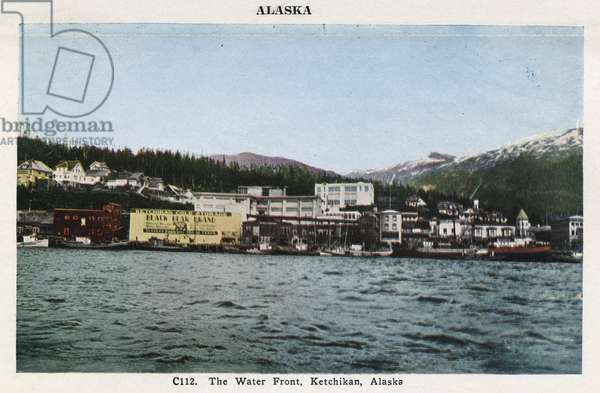 ALASKA: KETCHIKAN, c.1930 The water front at Ketchikan, Alaska. Postcard, American, c.1930.