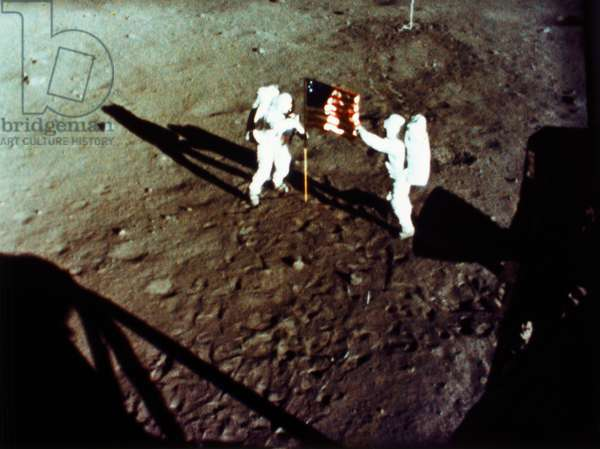 APOLLO 11: FLAG, 1969 Astronauts Neil Armstrong (left) and Edwin 'Buzz' Aldrin planting the American flag on the surface of the moon during the Apollo 11 lunar landing mission, 20 July 1969.