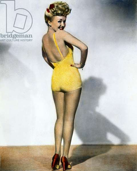 BETTY GRABLE (1916-1973) Oil over the most popular pin-up photograph of World War II.