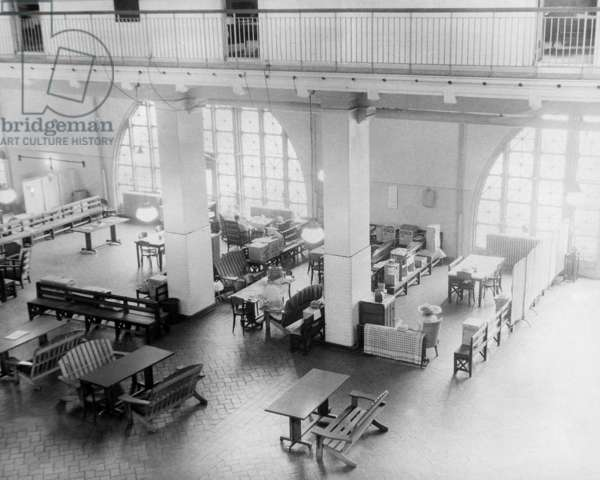 ELLIS ISLAND, c.1943 A gathering area (the former registry room) for German families detained as 'enemy aliens' at Ellis Island during World War II. Photograph, c.1943.