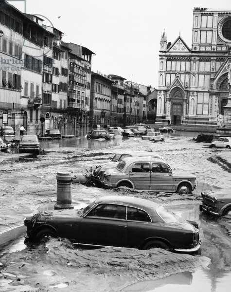 FLORENCE: FLOOD, 1966 Stranded cars in the square in front of the Basilica of the Holy Cross, during the flood of the Arno River in Florence. Photograph, 5 November 1966.