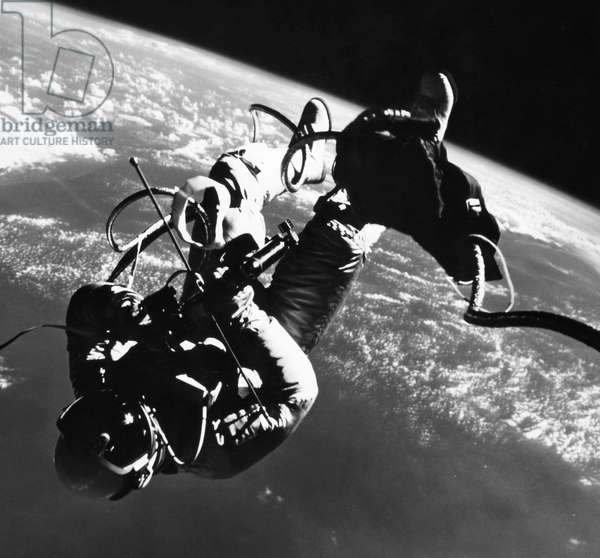 SPACE: GEMINI 4, 1965 Astronaut Edward H. White performing his spectacular space feat during the 3rd orbit of the Gemini-Titan 4 flight, 3 June 1965.