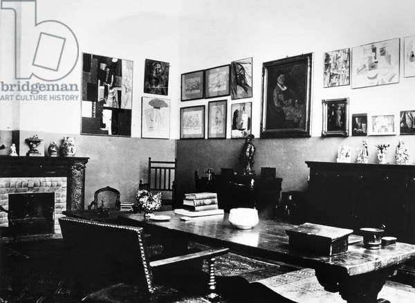 GERTRUDE STEIN (1874-1946) American writer. Interior of Stein's studio at 27 Rue de Fleurus in Paris. Photograph, c.1915.