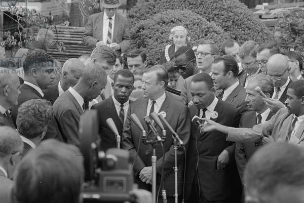 MARCH ON WASHINGTON, 1963 American civil rights leaders, including Roy Wilkins, John Lewis, and Martin Luther King Jr., meeting with President John F. Kennedy following the March on Washington. Photograph by Warren K. Leffler, 28 August 1963.