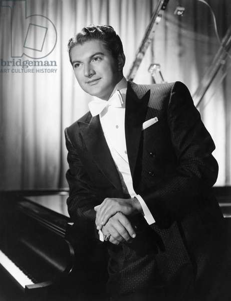 LIBERACE (1919-1987) Wladziu Valentino Liberace. American entertainer. In the film 'Sincerely Yours,' 1955.