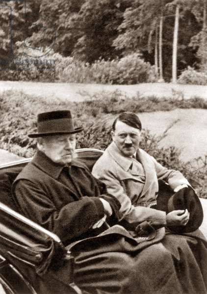 ADOLF HITLER (1889-1945) Chancellor of Germany, 1933-1945. Hitler (right) visiting with President Paul von Hindenburg at the latter's estate at Neudeck, Germany, in 1933.