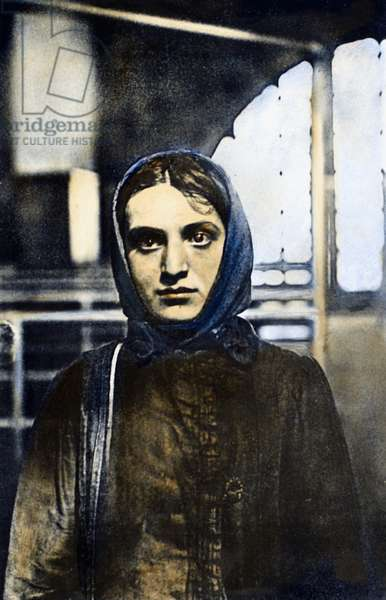 RUSSIAN JEWISH IMMIGRANT A young Russian Jewish woman photographed by Lewis Hine, upon her arrival at Ellis Island, New York City, 1905. Oil over a photograph.