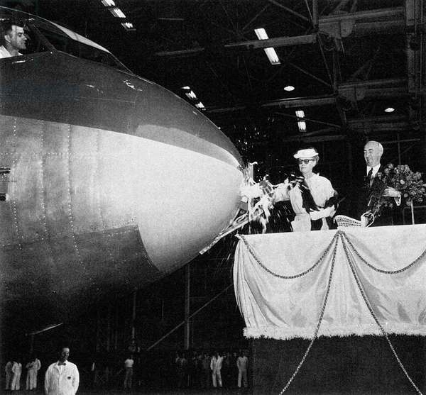 BOEING DASH 80, 1954 William Edward Boeing (1882-1956), co-founder of the Boeing Company, looks on as his wife, Marie, christens the Boeing 367-80, or 'Dash 80,' a prototype transport airplane, on 15 May 1954.