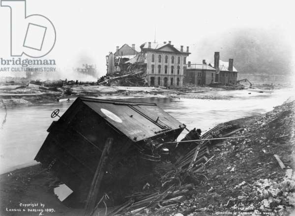 PENNSYLVANIA: FLOOD, 1889 The wrecked warehouse of the Cambria Iron Works after a flood at Johnstown, Pennsylvania, 31 May 1889.