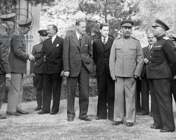TEHRAN CONFERENCE, 1943 Outside the Russian Embassy during the Tehran Conference, 1943. Left to right: British officer; American General George C. Marshall, shaking hands with Archibald Clark Keer, British Ambassador to USSR; Harry Hopkins, interpreter to Joseph Stalin; Joseph Stalin; Soviet Foreign Minister Vyacheslav Molotov; General Kliment Voroshilov.