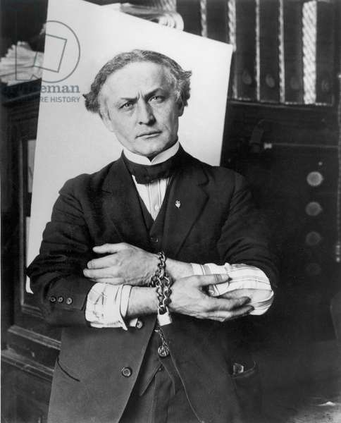 HARRY HOUDINI (1874-1926). American magician. Houdini, in handcuffs and chains, at the start of one of his miraculous escapes, February 27, 1918.