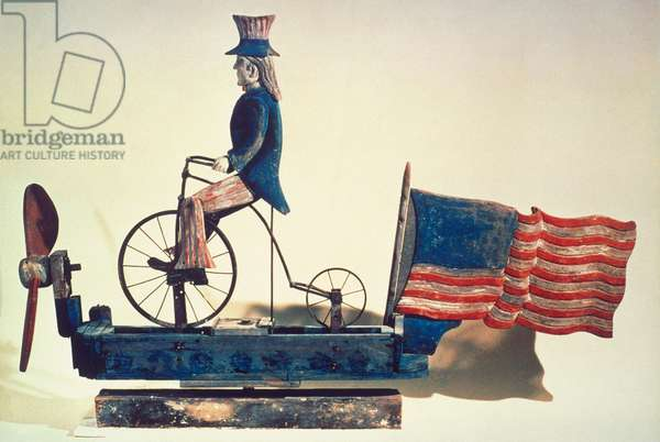 UNCLE SAM WHIRLIGIG, c.1876 American whirligig of Uncle Sam on bicycle. Wood and metal, c.1876.