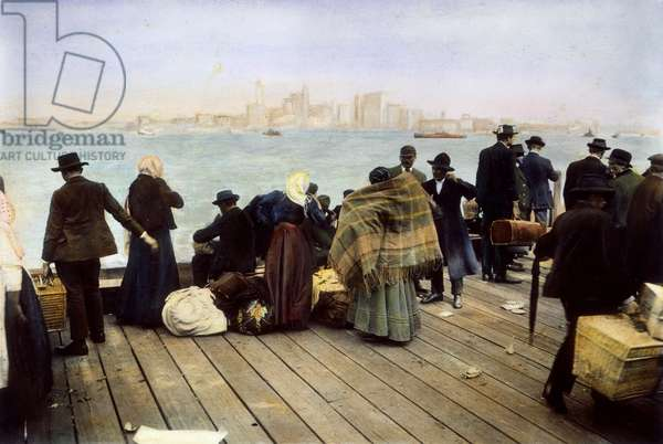 IMMIGRANT FAMILIES, 1900 Newly-landed European immigrants on the dock at Ellis Island in New York Harbor. Oil over a photograph, c.1900.