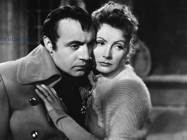 CONQUEST, 1937 Charles Boyer, as Napoleon I, and Greta Garbo, as Marie Walewska, in a scene from the film, 'Conquest.'