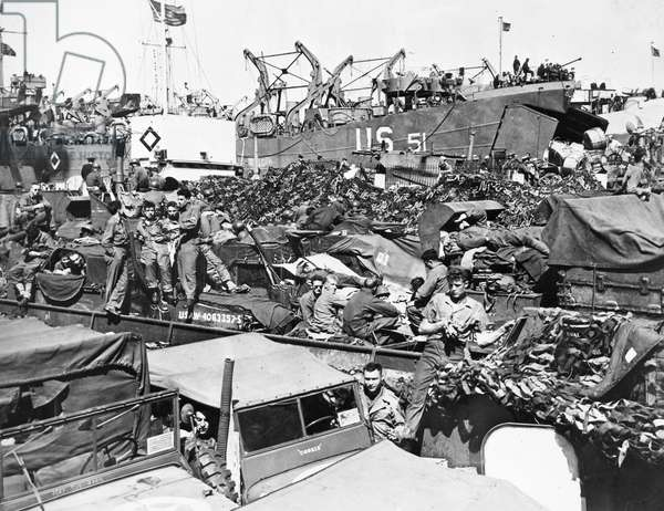 WORLD WAR II: D-DAY, 1944 American soldiers, on a loading dock in England, await sailing orders two days after D-Day.