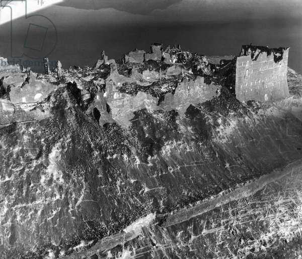 WWII: MONTE CASSINO, 1944 Aerial view of the Abbey of Monte Cassino on Monastery Hill in Cassino, Italy, after a bombing during the Battle of Monte Cassino. Photograph, 1944.