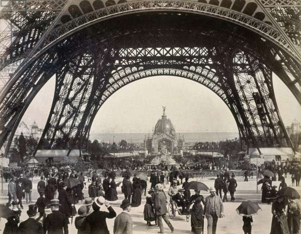 PARIS EXPOSITION, 1889 Crowds walking under the base of the Eiffel Tower while attending the Universal Expostion in Paris, 1889, looking toward the Central Dome.