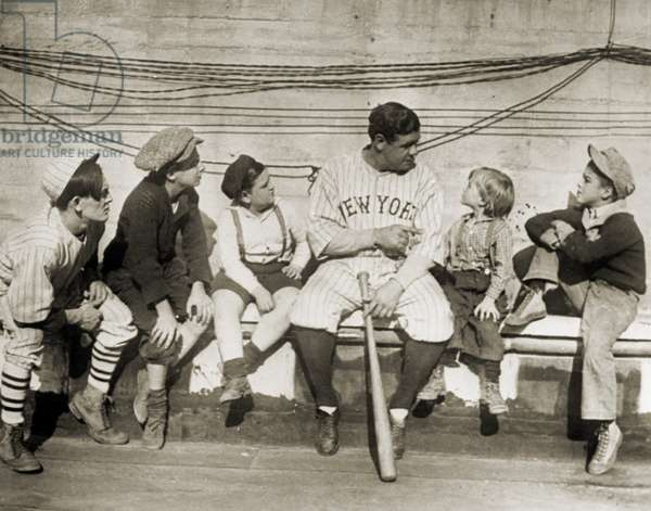 GEORGE H. RUTH (1895-1948) Known as Babe Ruth. American baseball player. Ruth talking to a group of children, while playing for the New York Yankees. Photograph, 1924.