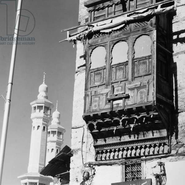 MECCA: HOUSE A traditional house with wooden window shutters in Mecca, Saudi Arabia, c.1975.