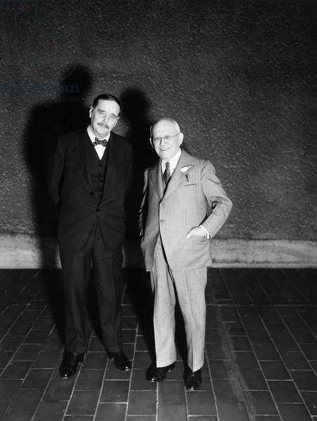 HERBERT GEORGE WELLS (1866-1946). English writer. Wells (left) with Carl Laemmle, head of Universal Pictures Corp. in 1936.