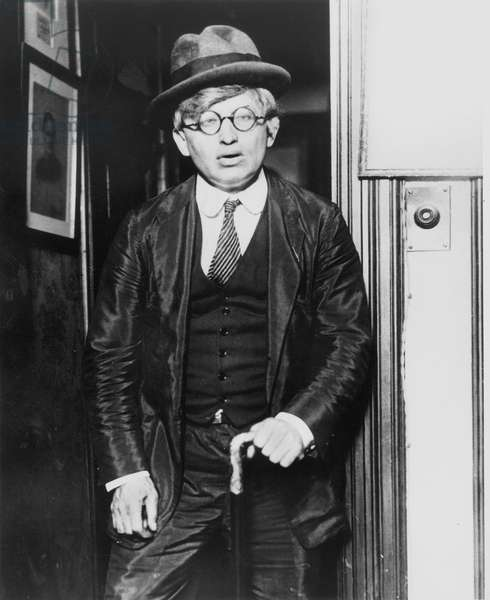 HARRY HOUDINI (1874-1926) American magician. Houdini disguised as an old man in order to enter the home of a medium and expose a fake seance, July 2, 1925.