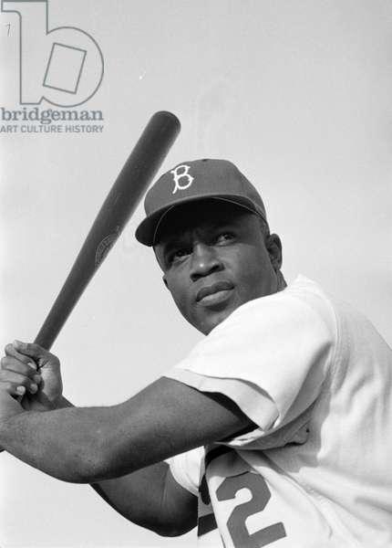 JACKIE ROBINSON (1919-1972) American baseball player. Photograph by Bob Sandberg, 1954.