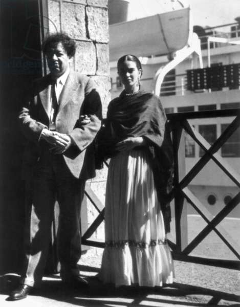 KAHLO & RIVERA, 1930 Frida Kahlo (1907-1954) with Diego Rivera (1886-1957), both Mexican artists. Photographed in 1930.