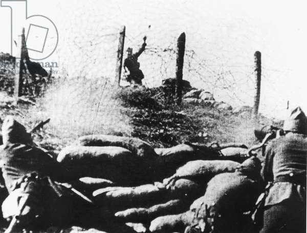 SPANISH CIVIL WAR, 1936 A Nationalist soldier under fire tosses a lethal hand grenade into a Republican machine gun stronghold near Burgos, 9 December 1936.