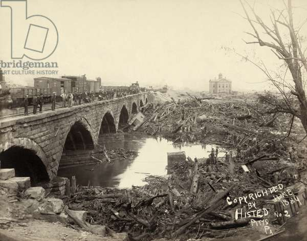 JOHNSTOWN FLOOD, 1889 Debris at the Pennsylvania Railroad Bridge in Johnstown, Pennsylvania, after the Johnstown Flood. Photograph by Ernest Walter Histed, 1889.