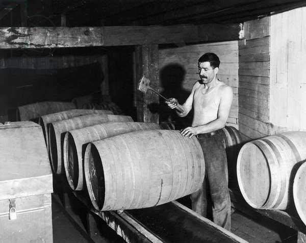 PROHIBITION REPEAL, 1933 In preparation for the repeal of prohibition, a worker empties barrels of whiskey into a container for bottling at the Joseph Finch Company, Schenley, Pennsylvania, 28 August 1933.