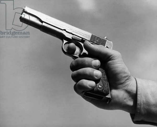 COLT .45 PISTOL, 1940s Colt automatic pistol, .45 caliber (US Army M1911). Photograph, early 1940s.