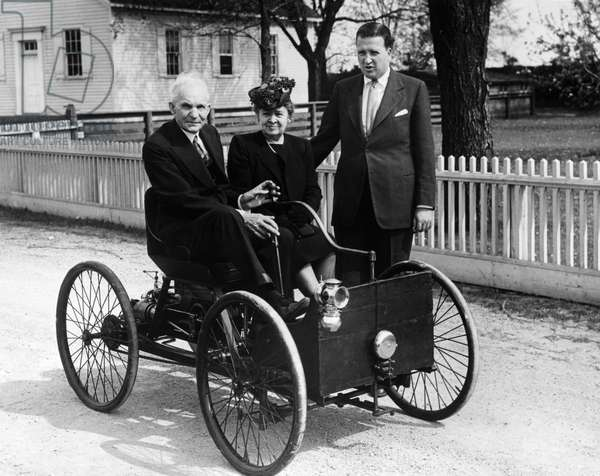 HENRY FORD (1853-1947) American automobile manufacturer. Ford with his wife, Clara, and his grandson, Henry Ford II, with his first automobile invented in 1896. Photograph, c.1945.