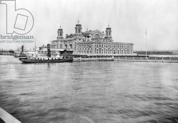 ELLIS ISLAND, c.1913 The main building at the immigration station in New York Harbor, c.1913.