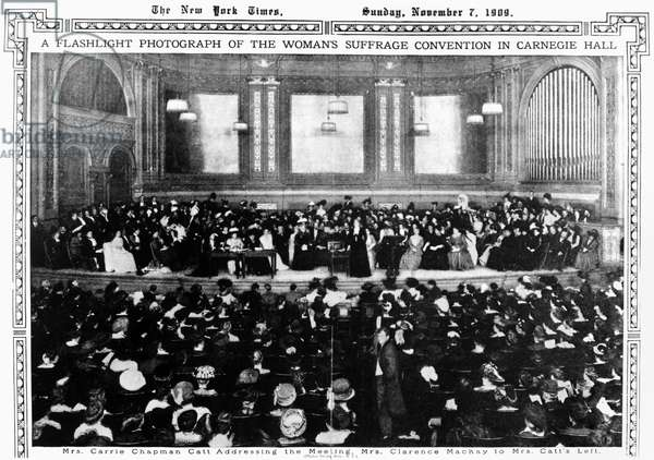 CARRIE CHAPMAN CATT (1859-1947). Carrie Clinton Chapman Catt. American reformer and women's rights advocate. 'A flashlight photograph of the Woman's Suffrage Convention in Carnegie Hall. Mrs. Carrie Chapman Catt addressing the meeting, Mrs. Clarence Mackay to Mrs. Catt's left.' Photograph, 7 November 1909.