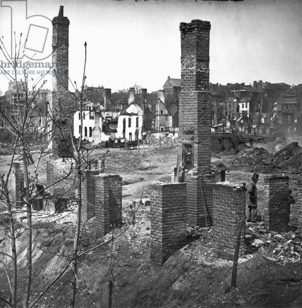 CIVIL WAR: RICHMOND, 1865 Chimney's amidst the ruins in the burned district of Richmond, Virginia following the American Civil War. Photograph, April 1865.