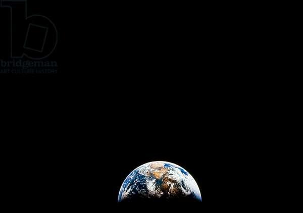 APOLLO 11: EARTH, 1969 A view of earth from the Apollo 11 spacecraft. Photograph, 1969.