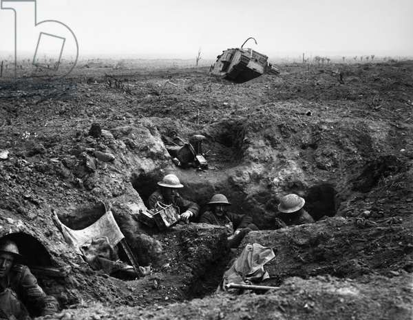 WORLD WAR I: YPRES, 1917 British troops in a gun-pit trench with a destroyed Mark IV tank in the background. Photographed during the battle at Menin Road Ridge, part of the Battle of Ypres, 22 September 1917.