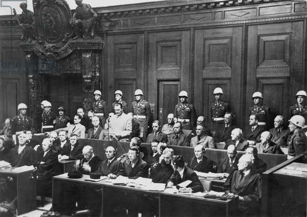NUREMBERG TRIALS (1945-1946) Hermann Goering, standing, with Rudolf Hess at the far left. Photograph, 1945-46.