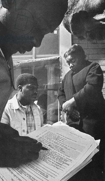 FREEDOM SUMMER, 1964 Two civil rights activists help an African American couple from Mississippi register to vote during the Freedom Summer of 1964.